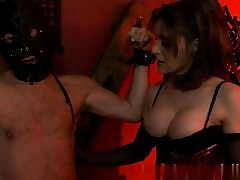 Sexy stunner dressed in a slutty corset and sexually abusing her victim