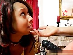 Hot girl wearing a strap-on penetrating her girlfriend's insatiable mouth