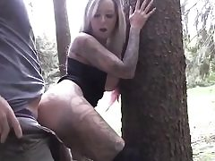 Long haired blonde having fuck-a-thon with her bf in the forest